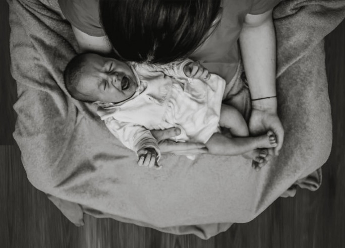 21 Tips to Soothing a Crying Baby - Mom with Crying Baby