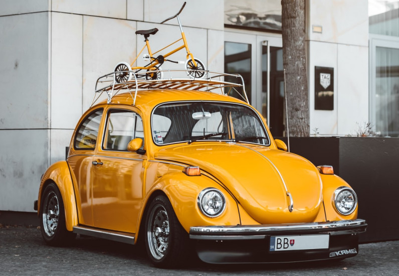 How to Save Money as a Stay At Home Mom - Car with Bike on Roof