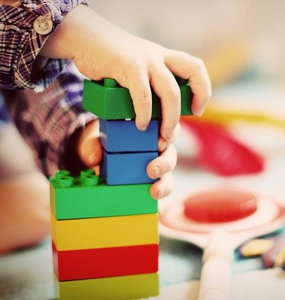 How to Pack for a Move with a Baby - Child Playing with Colored Blocks