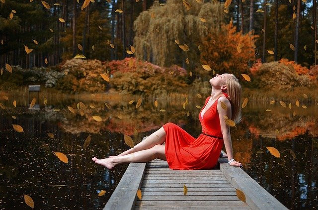 How to Keep Motivated Even on Your Worst Days - Woman Sitting on Dock with Eyes Closed