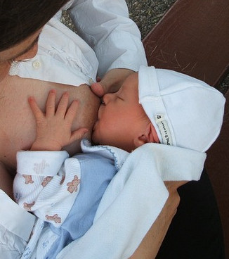 10 Amazing Benefits of Breastfeeding - Woman Breastfeeding Baby
