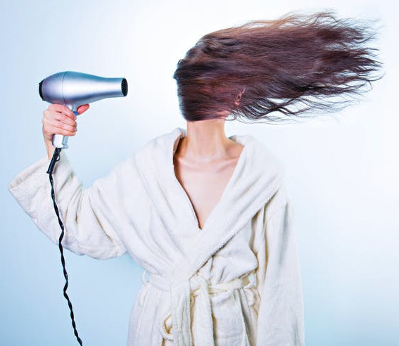 How to Be Happy as a Stay At Home Mom - Woman Blow Drying Hair