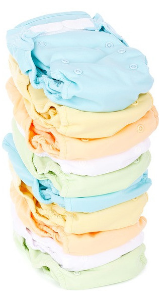 What to Expect on the First Day Home with a Newborn - Stack of Cloth Diapers