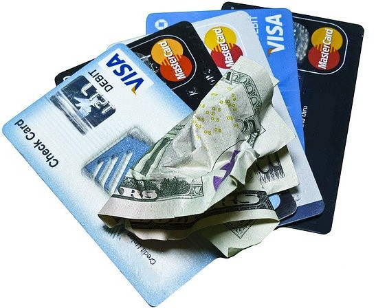 9 Ways to Create an Emergency Fund - Debit Cards and Crumbled Bill