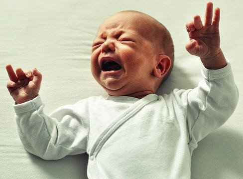 What to Expect on the First Day Home with a Newborn - Crying Baby with Clothes