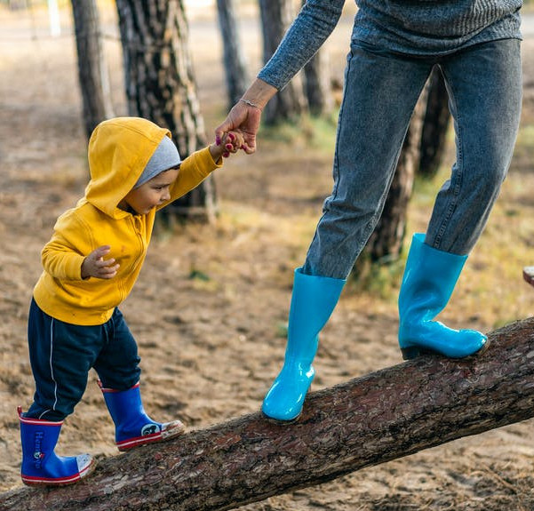 3 Ways to Combat Loneliness as a Stay At Home Mom - Mom and Child Walking Up a Fallen Tree