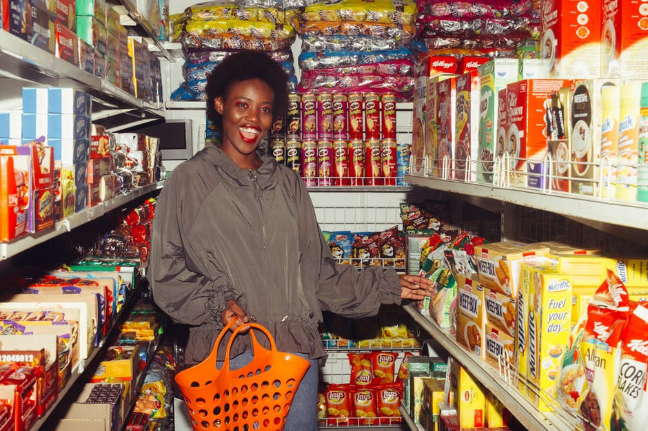 How to Stockpile Food - Woman Shopping her Food Stockpile