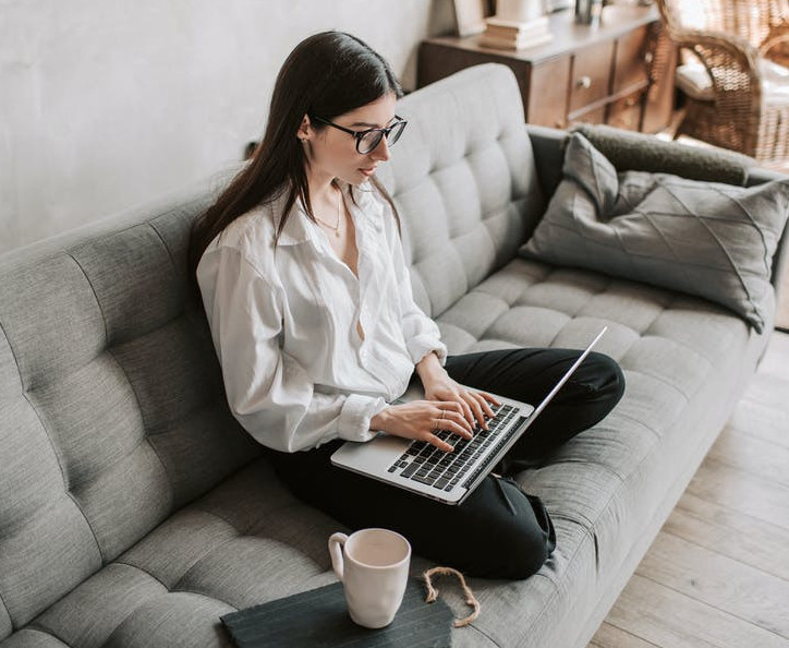 How Can I Afford to be a Stay At Home Mom - Woman on Laptop on Couch