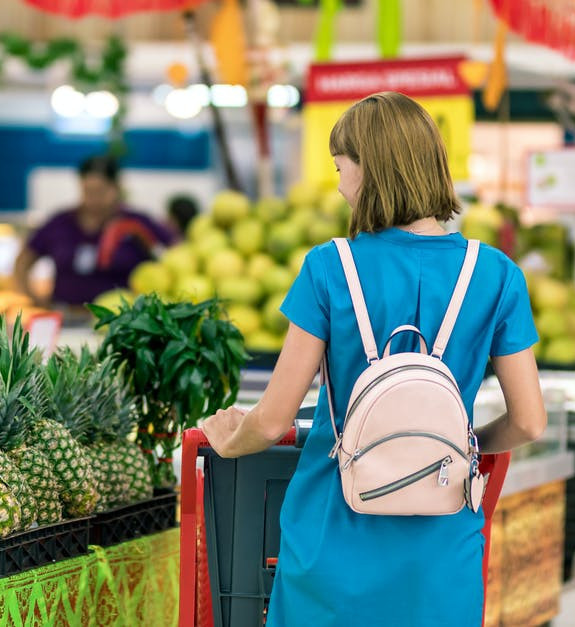 The Quickest Ways to Save Money at the Grocery Store - Woman Shopping for Pineapple