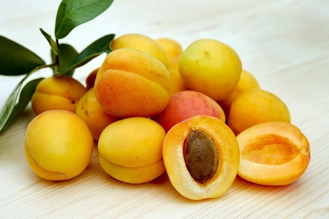 A bunch of apricots on table