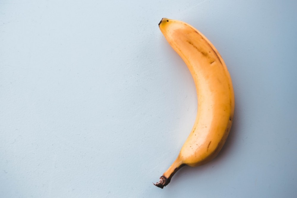 Ripe, medium sized banana on table