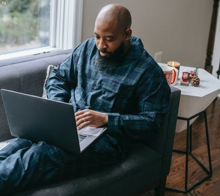 what is e-research-global-An image of a man working using a laptop