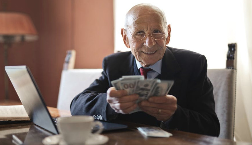 Online surveys that pay money-An image of a man holding money