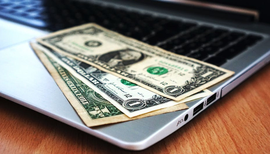 What is e-research-global?An image of money on a laptop