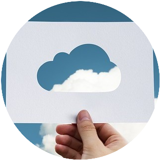 paper cutout of cloud with sky in background