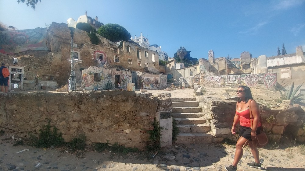 Woman walks alongside ancient city ruins