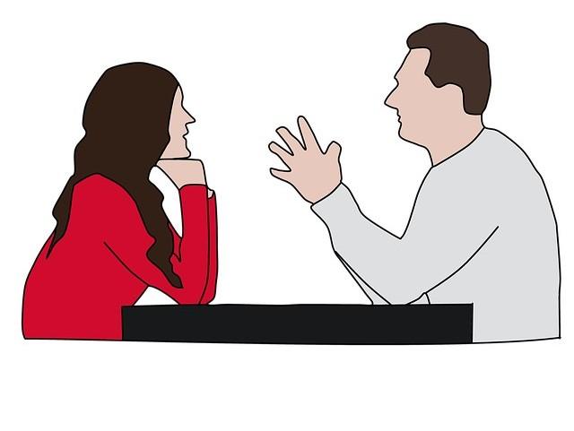 Cartoon of man speaking to woman