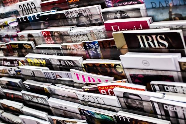 Magazines on rack. Photo by Charisse Kenion on Unsplash