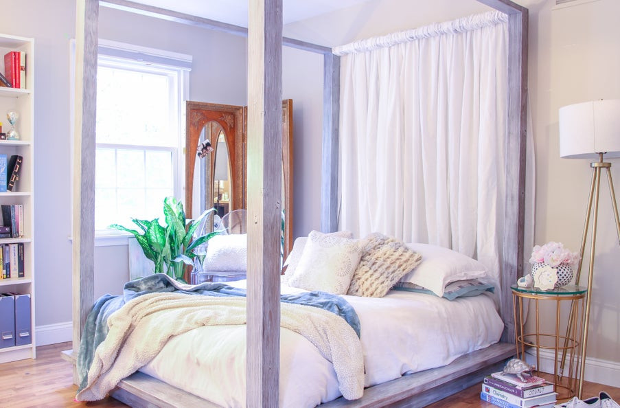 Grey stained canopy-style DIY Platform bed