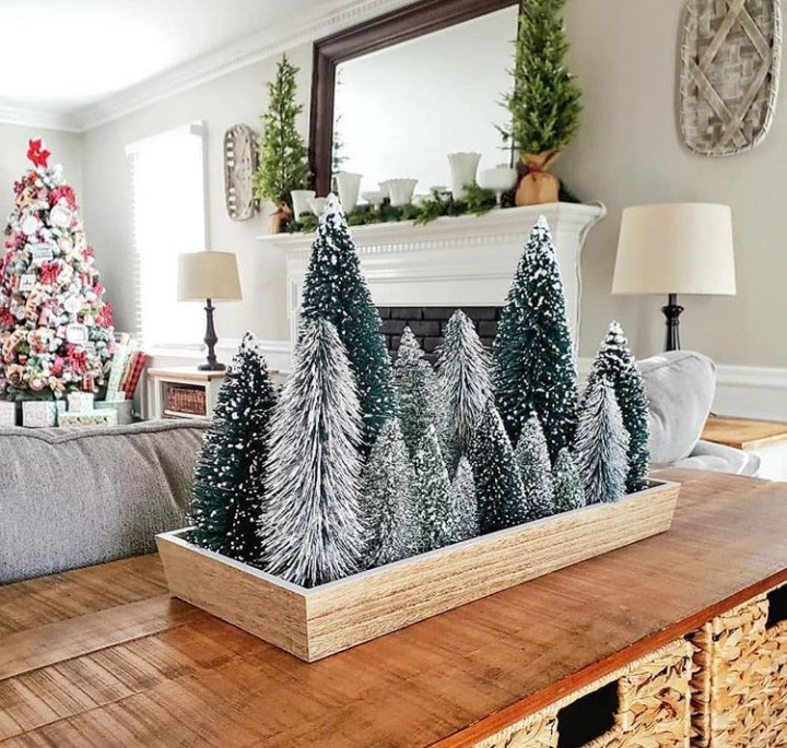 Forgo a regular Christmas tree with a small potted spruce to save o space this year.