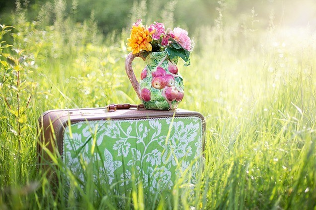 suitcase and flowers