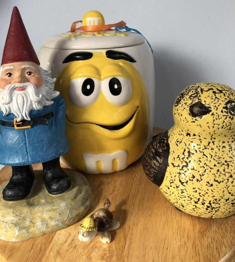 Traveling gnome, M&M container, bobble head turtle and yellow bird