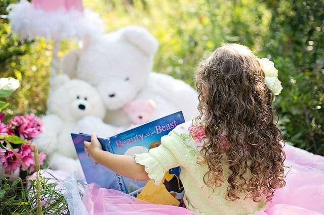 stay connected with friends and family - little girl reading to stuffed animals