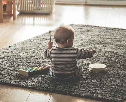 baby playing musical instruments