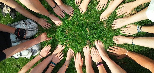 What Is The Meaning Of Leadership? - group with the feet and hands in the middle