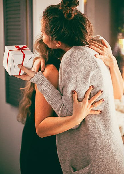 Thankful vs Grateful - women hugging
