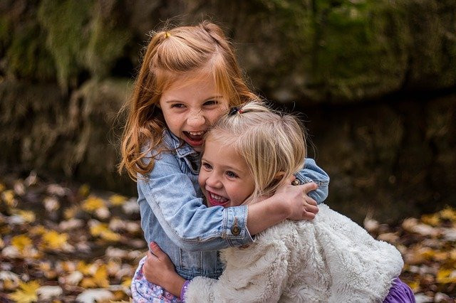 What Is A People Pleaser - little sisters hugging
