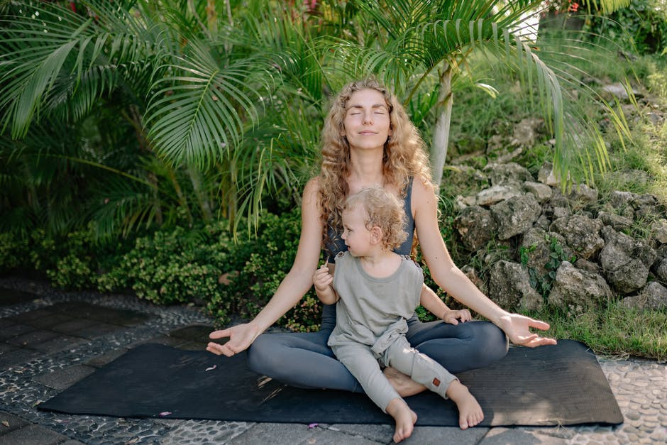 What is Meditation and How It Works - woman meditating with child
