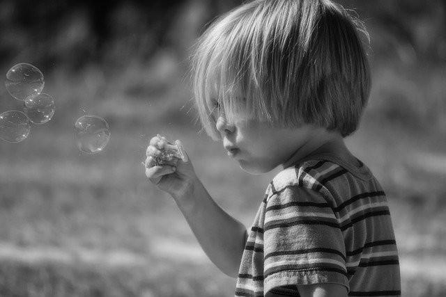 Kids Summer Activities - kid blowing bubbles