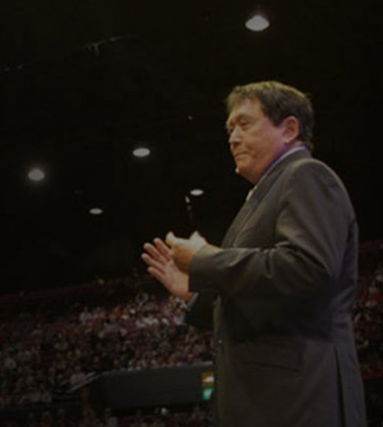What Is Rich Dad Summit About - Robert Kiyosaki speaking on stage