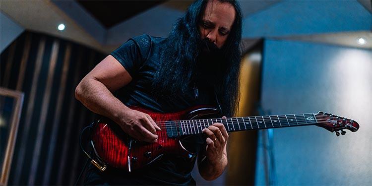 John Petrucci playing a Sterling by Music Man Majesty guitar