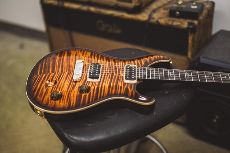PRS guitar lying on a stool
