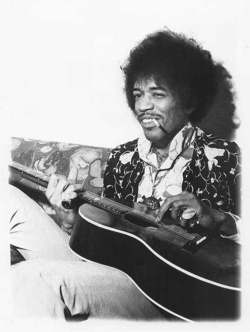 Jimi Hendrix playing his Epiphone FT 79 Acoustic Guitar