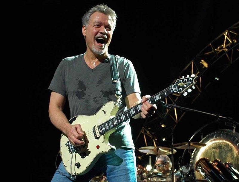 Eddie Van Halen playing an ivory EVH Wolfgang USA signature guitar