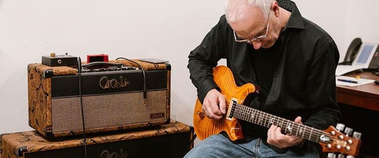 Paul Reed Smith playing a PRS guitar