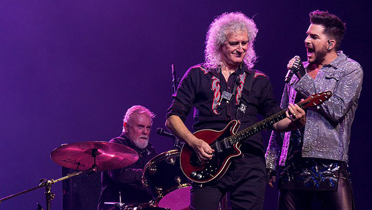Queen and Adam Lambert performing