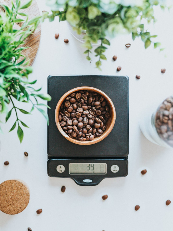 How to make meal prep easy - electronic food scales measuring coffee beans on table
