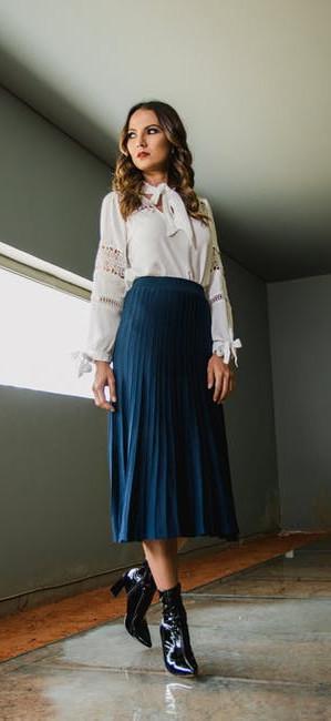 women in pleated skirt