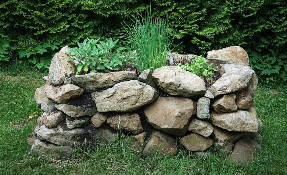 dry stack stone raised garden bed
