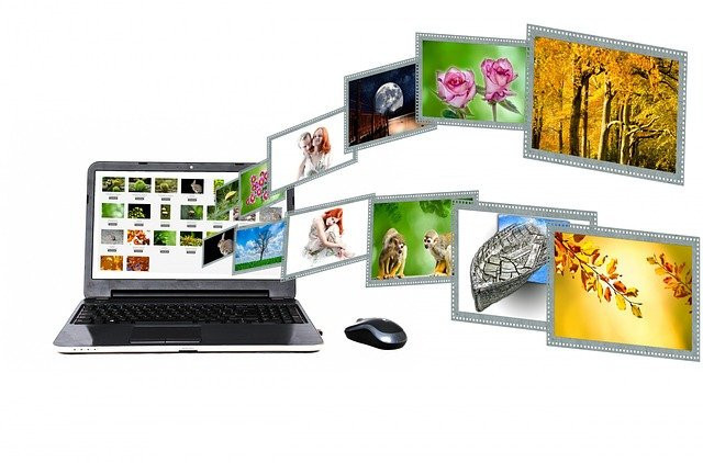Laptop-with-images-floating-out-of-it