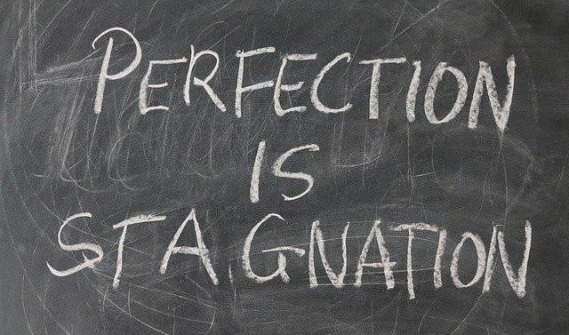 Perfection-Is-Stagnation-written-on-a-blackboard