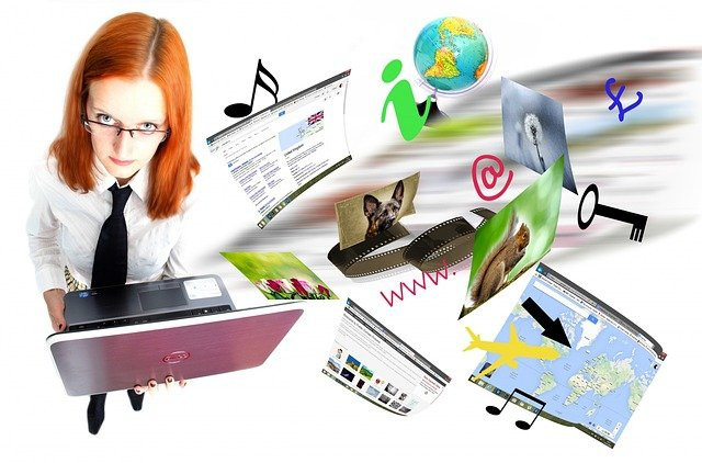 lady-holding-a-laptop-with-images-flying-around