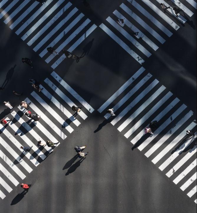 People-Walking-Across-A-Zebra-Crossing