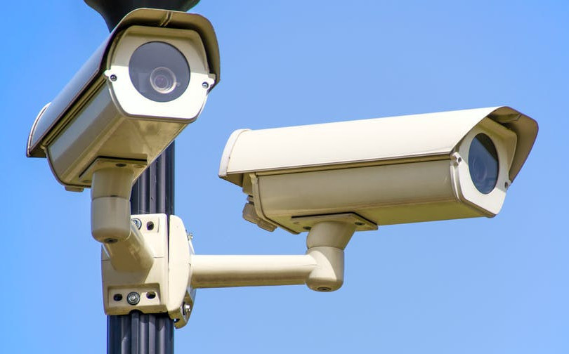 Two outdoor surveillance cameras on a pole