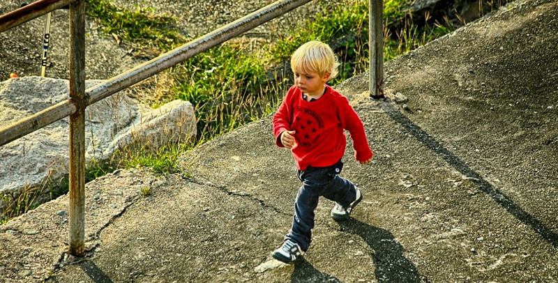 A child walking along a path