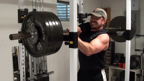 Nick Nilsson Doing a 500lb One Shoulder Lockout